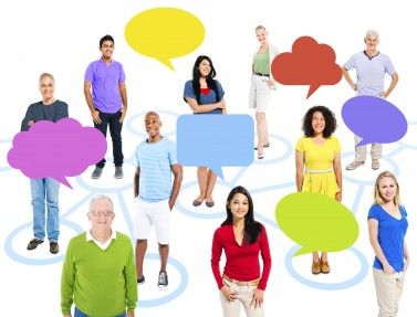 Group of multi-ethnic people in a connection themed picture with empty speech bubbles.